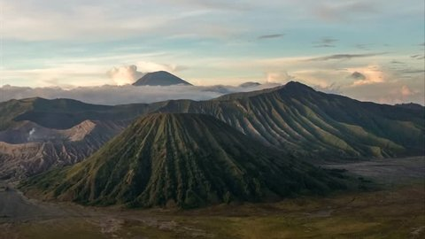 4K Tiime Lapse of Amazing Clouds and Sand movenent at The Majestic Mount of Bromo, Batok and Semeru, East Java, Indonesia.