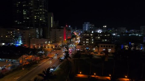 Aerial night Miami Beach Collins avenue weekends