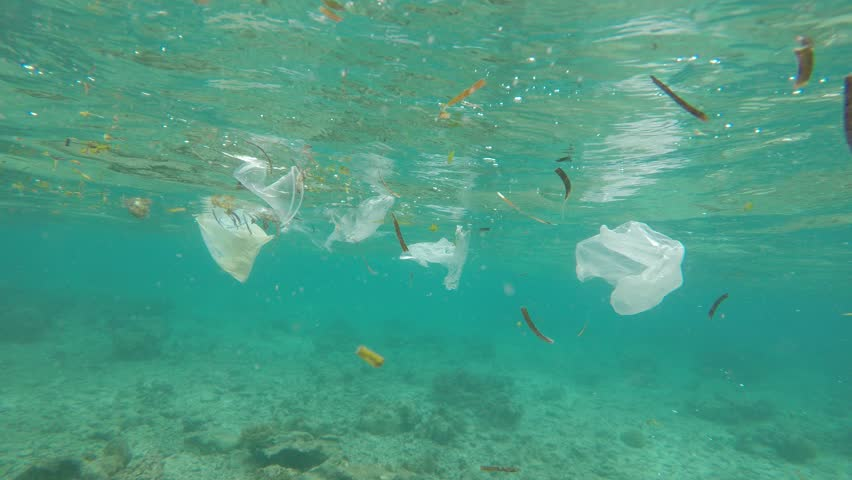Plastic pollution in ocean environmental problem. Plastic bags, cups, straws and bottles discarded in sea