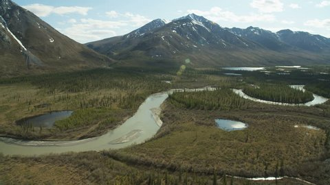 Aerial scenic view Brooks Mountain Range glacial river valley a National wildlife refuge and Preserve a wilderness within the Arctic circle Alaska USA