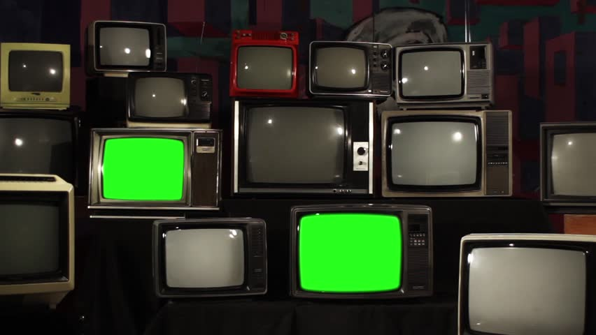 Aesthetic Televisions of the 80s with Green Screens that Light Up. Zoom In Fast. Ready to replace green screen with any footage or picture you want.  | Shutterstock HD Video #1010055179