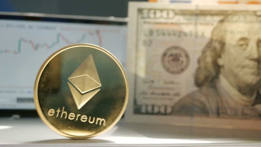 Golden ethereum ETH fluttering on the background of a graphic stock chart | Shutterstock HD Video #1010059619