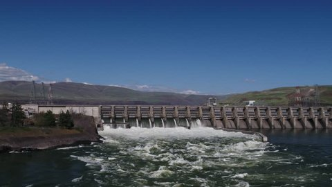 The Dalles dam with an angle of the spillways and rapids with seagulls flying around.