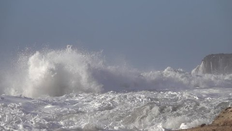 Splashes from atlantic ocean big waves over cliffs, slow motion