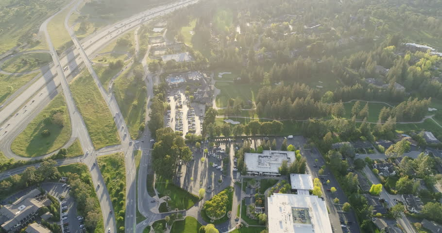 Aerial: Flying over Sandhill Road and the 280 Freeway, home of venture capital firms. Menlo Park, Silicon Valley. 19 April 2018 | Shutterstock HD Video #1010086019