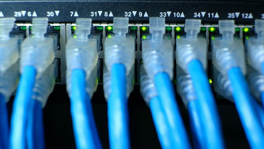 Network cable connecting on Network gigabit switch and LED port status is blink. UTP port cat6 for high speed network in data server room. close up and selective focus | Shutterstock HD Video #1010104409