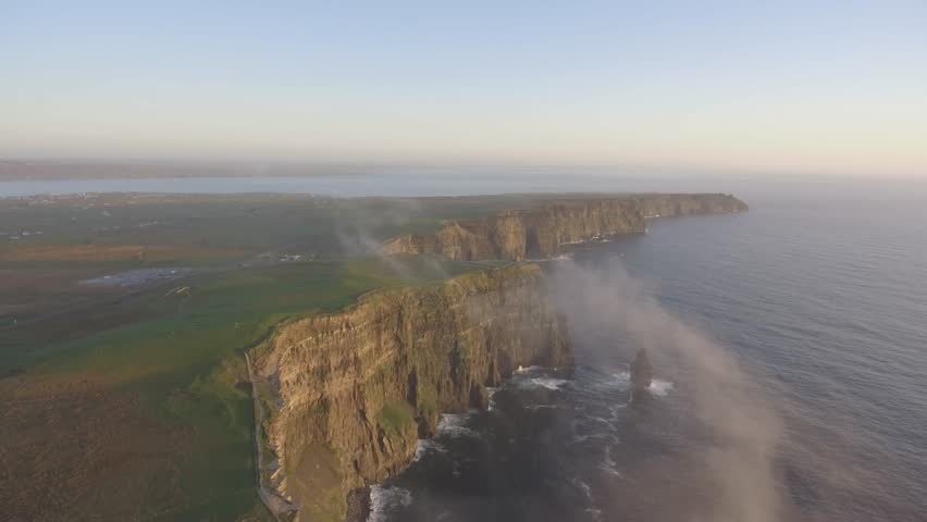 Beautiful Scenic Aerial drone view of Ireland Cliffs Of Moher in County Clare. Sunset over the Cliffs of Moher. Epic Irish rural countryside landscape along the wild atlantic way | Shutterstock HD Video #1010112089