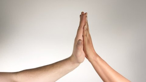 4K inter-racial couple man and woman white and black high five hands against white background