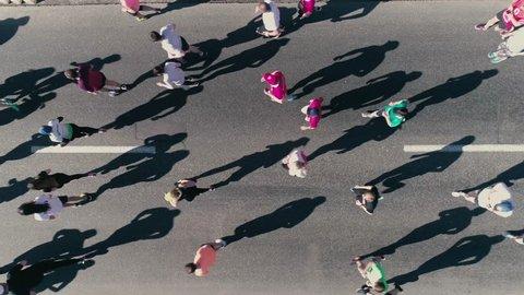 4K Aerial drone fooage. Marathon running on street. Top view close up