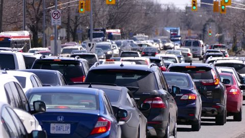 Toronto, Ontario, Canada April 2018 Toronto traffic jam and gridlock on city streets with heat waves rising