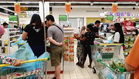 selangor, malaysia - april 21, 2018 : Unidentified people line up a long queue and checkout in a supermarket
