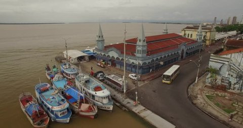 Aerial passing the historic Ver-o-Peso market in old port town of Belem do Para in the Brazilian Amazon revealing the river in the background