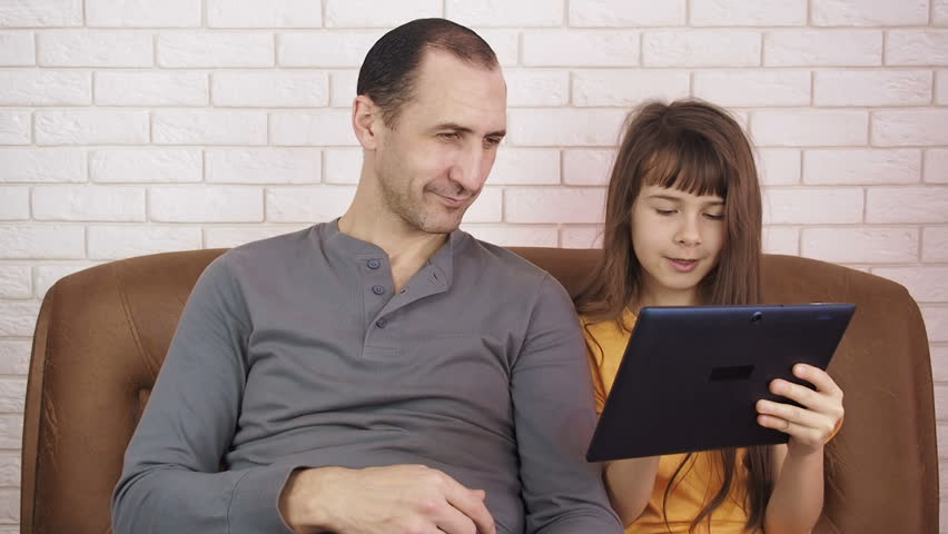 Family with a tablet. Father with daughter on the Internet. | Shutterstock HD Video #1010224139