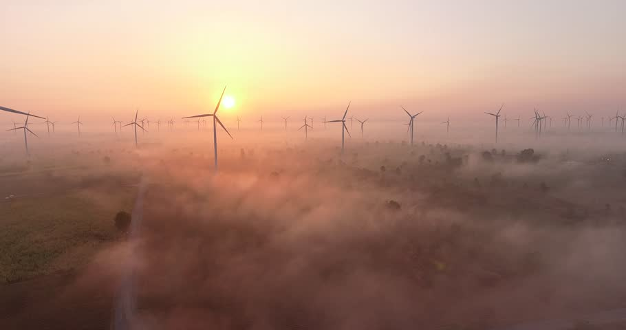 Aerial view of Wind turbines Energy Production- 4k aerial shot on sunset. 4k drone footage turbines at sunrise with clouds #1010225909