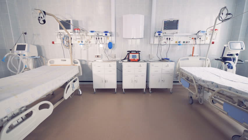 Two empty bed in a hospital room with medical equipment. 4K.