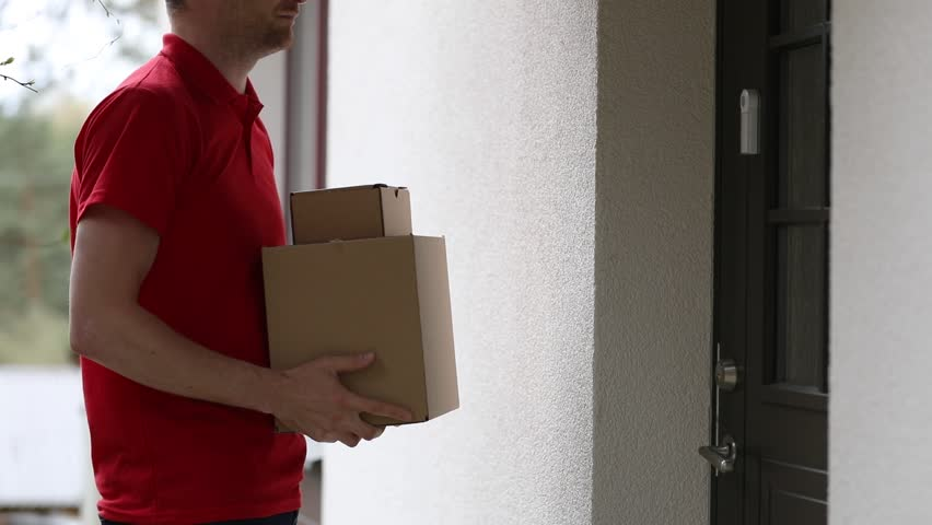 Home delivery service - accepting a delivery of boxes from deliveryman | Shutterstock HD Video #1010247779