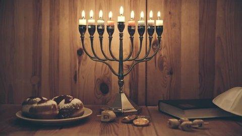 Menorah with burning candles and donuts, Hanukkah Holidays