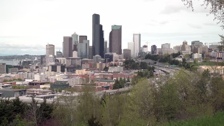 Downtown Seattle Skyline and Freeway 4K UHD. Downtown Seattle skyline with the Interstate 5 freeway passing by. Washington State, USA. 4K, UHD,
