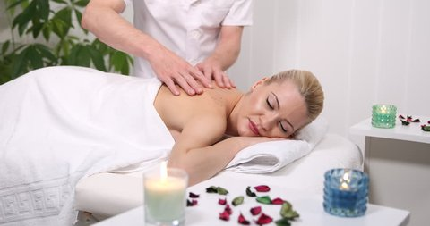 Portrait of Good Looking Blonde Hair Woman Receiving a Massage Lying Spa Center