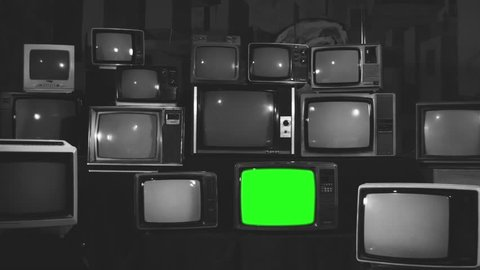 80s televisions with green screens turning off  kodak black and white tone   ready to replace green screen with any footage or picture you want