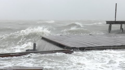 Rockport, TX/US - August 26, 2017 [Major Hurricane Harvey making landfall in Rockport, Texas. Hurricane winds, storm surge flooding damaging docks and houses.]