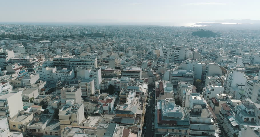 4K Athens aerial downtown buildings rooftops.Aerial views of tight concrete buildings and vertical views of, typical downtown neighbourhoods streets and rooftops near the center of Athens. | Shutterstock HD Video #1010408189