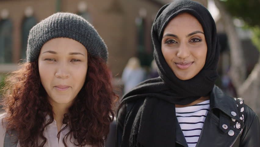Portrait of two young multi ethnic woman friends laughing happy at camera enjoying relaxed lifestyle togetherness friendship | Shutterstock HD Video #1010441339