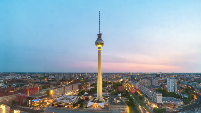 Berlin city skyline day to night timelapse at alexanderplatz with Berlin TV Tower (Berliner Fernsehturm), Berlin, Germany 4K Time lapse