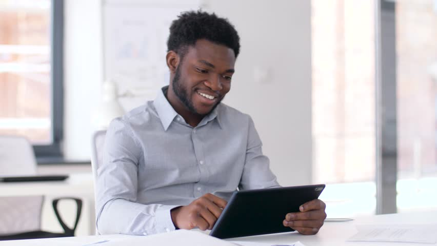 Business, people and technology concept - african american businessman with tablet pc computer at office | Shutterstock HD Video #1010447249