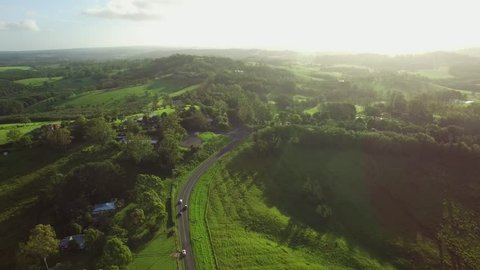 Forward flight over beautiful lush green countryside towards the sun at sunset. Brooklet, New South Wales, Australia