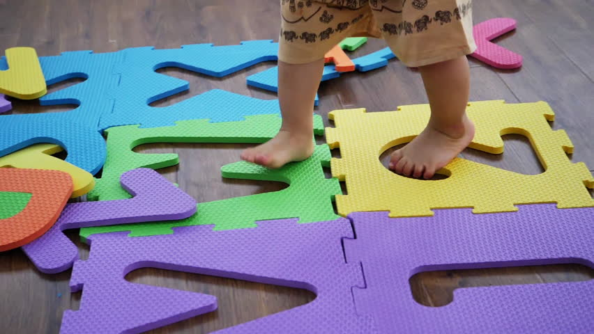 Colorful floor puzzle mats for baby and child play and education learning word number | Shutterstock HD Video #1010498879