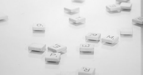 Tiles assemble to spell WORD white background