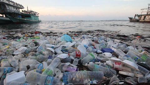 SEMPORNA, MALAYSIA - CIRCA MAY 2018: Plastic bottles and bags pollution in the ocean. Environmental pollution problem