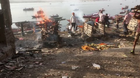 Varanasi / India 27 March 2018  Hindu cremation ceremony at Manikarnika Ghat on banks of holy Ganges river at Varanasi  Uttar Pradesh India