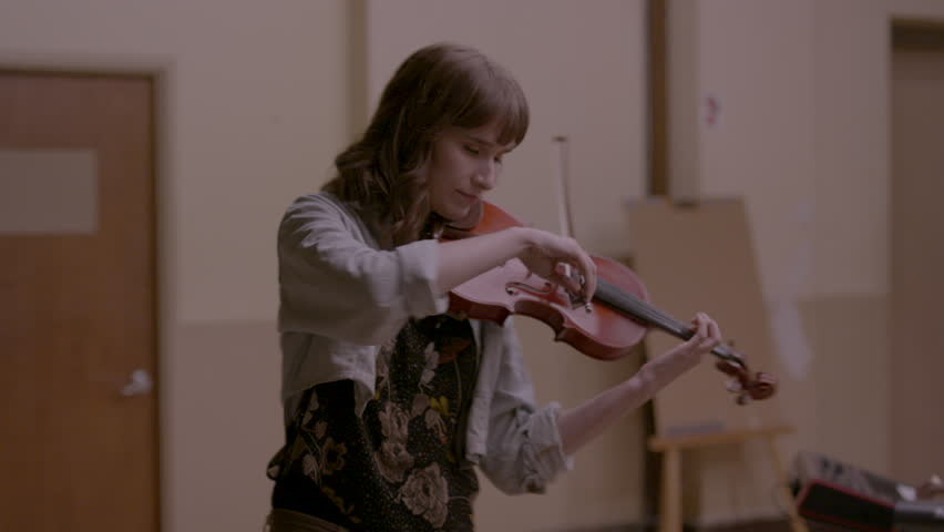 Female musician happily playing her violin HD stock video. Alexa camera