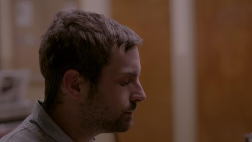 Close up of musician at piano HD stock video. Alexa camera