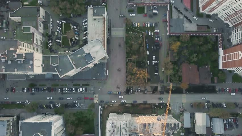 Construction in the city with a crane manipulator. Video. Top view of the construction site in the city #1010523179