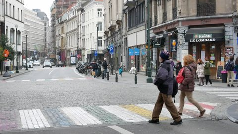 BRUSSELS - JANUARY 12, 2018: People on colorful pedestrian crossing in Brussels in the winter day.