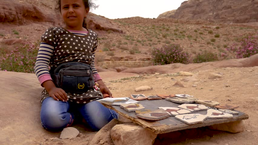 separation shoes e66d7 8f1bd Petra, NA   Jordan - 04 21 2018  Petra, Jordan April 2018  View of the  crafts a cute, young Bedouin girl is selling then zooms out to reveal the  whole scene