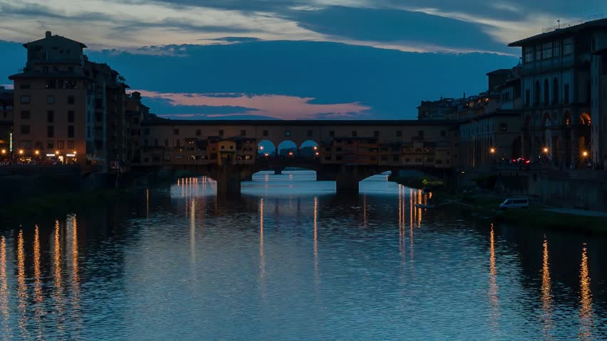 Sunset in Florence. view of Florence Ponte Vecchio over Arno River in Florence timelapse, Italy. One of the main landmarks in Florence. Close up