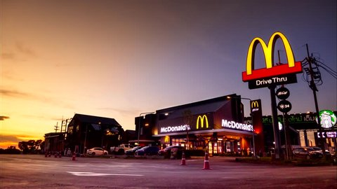 AYUTTHAYA - MAY 6 : McDonald's in Thailand at sunset, Corporation is the world's largest chain of hamburger fast food restaurants, during the day hours on May 6, 2018, Ayutthaya Thailand.
