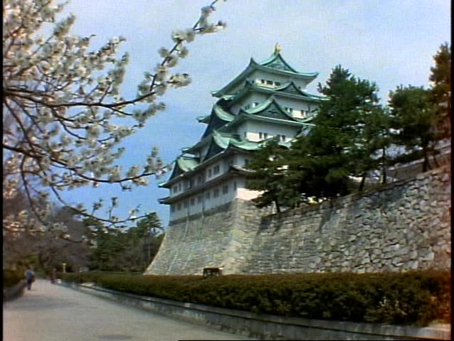 JAPAN, 1999, Nagoya Castle, cherry blossoms in foreground, very wide shot