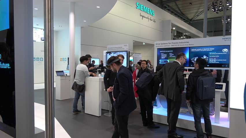 Hannover, Germany - April, 2018: Visitors on Siemens stand on Messe fair in Hannover, Germany