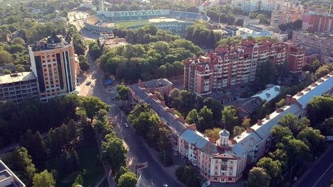 POLTAVA, UKRAINE - MAY 10, 2018: main Poltava city square with cars and trees in sunrise light.