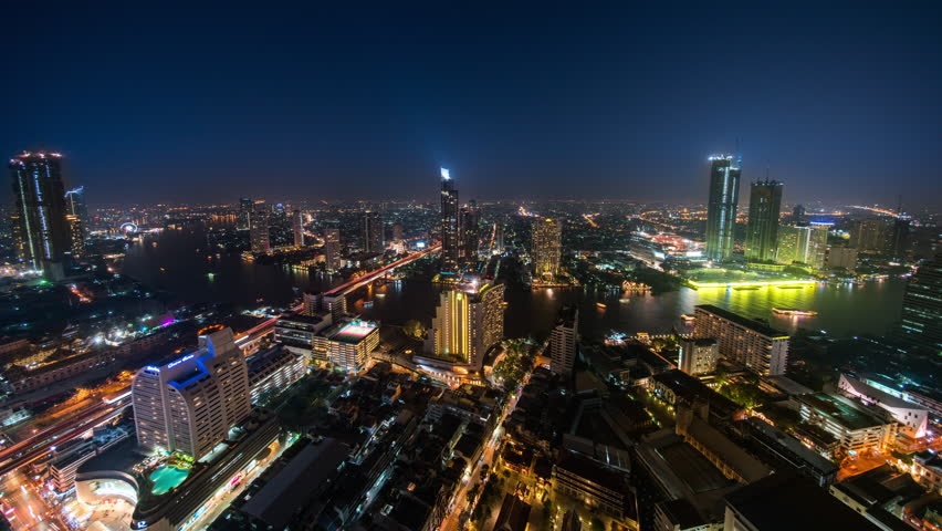 Bangkok, Thailand - January 3, 2018: Bangkok Timelapse view showing city skyline and view over lightshow and Chao Phraya river at night