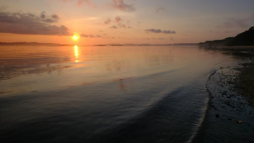 Flowing sea water tides by the beach shore | Shutterstock HD Video #1010900639