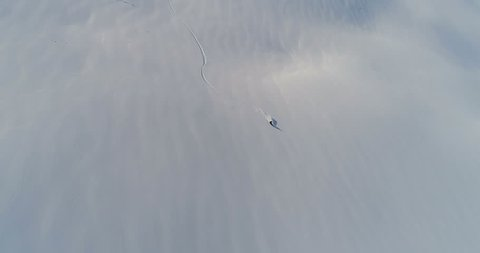 Person Snowboarding Down Slope Drone Aerial Birds Eye View Above White Powder Snow - Winter Extreme Sports Background fresh snow, skiing backcountry