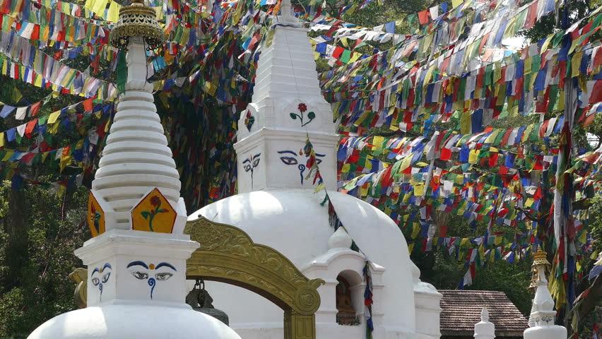 Prayer Stupas and flags in Swayambhunath Buddhist temple at Kathmandu, Nepal.