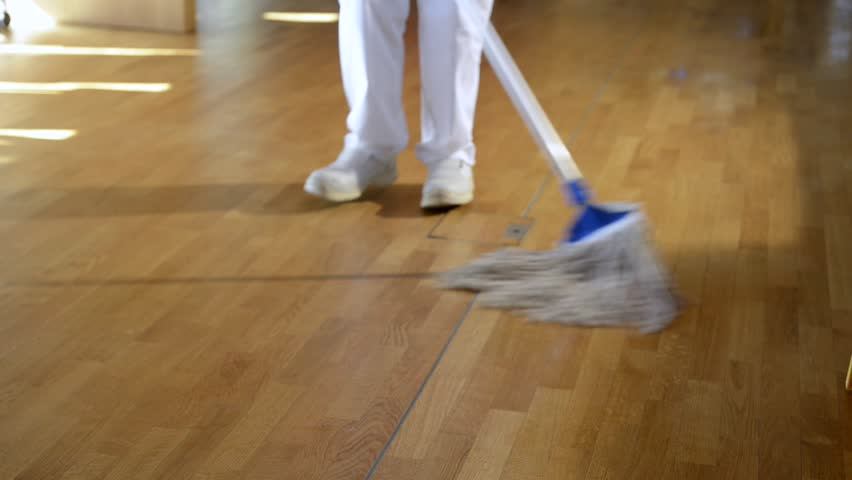 video of unrecognizable cleaning woman cleaning a wooden floor
