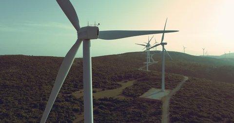 Aerial big wind turbine farm installation on mountain.Drone establishing shot of a wind farm installation on top of a mountain.